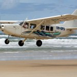 Air Fraser Island taking off from beach near Eliza Fraser Lodge eco-tourism on beautiful Fraser Island, Australia